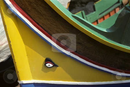 Yellow sailing boat stock photo, Bow of wooden sailing boat with carved eye on the prow by Steven Heap