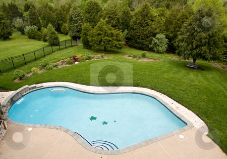 Overview of luxury pool stock photo, View of luxury pool and deck with surrounding landscaped garden with flowers and trees by Steven Heap