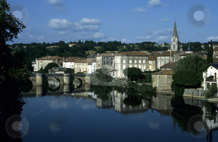 Reflection of old town stock photo, Old french town reflected in a still river crossed by a stone arched bridge by Steven Heap