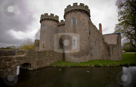 Whittington Castle stock photo, Whittington Castle in Shropshire reflected in moat with cloudy sky by Steven Heap