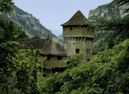 Castle in rocky valley stock photo, Sone turrets on castle in rocky gorge in Europe by Steven Heap