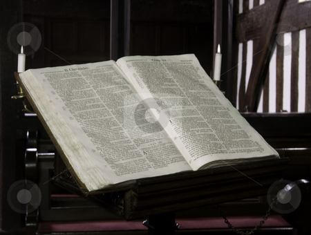 Ancient Church Bible stock photo, Close -up of the old church bible in Melverley Church in Shropshire illuminated by candles by Steven Heap