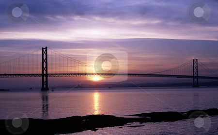 Forth Road Bridge at sunset stock photo, Forth Road Bridge near Edinburgh at sunset with the sun reflected in the River Forth by Steven Heap