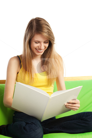 Smiling young blond woman with book stock photo, Happy young blond woman reading a book with blank cover; isolated on white by Mikhail Lavrenov