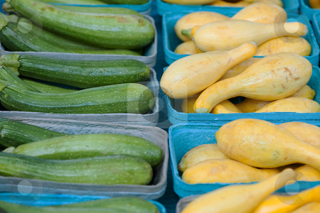 Green and yellow goodness stock photo, Green cucumbers and yellow squash for sale at the farmer's market by Gerry Daniel