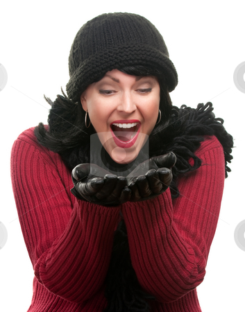 Excited Woman In Winter Clothes Holds Her Hands Out stock photo, Excited Woman In Winter Clothes Holds Her Hands Out Isolated on a White Background. by Andy Dean