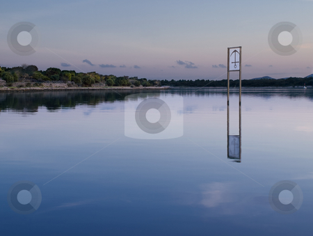 A place to dock stock photo, Bay with the anchor sign-board in the shallow water , peaceful scene in the sunset by Vladimir Koletic