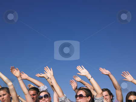 People With Arms Raised stock photo, People with hands in the air, with only their faces visible. Horizontal. by Mog Ddl