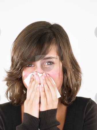 Young Woman Blowing Nose stock photo, Young woman with cold, blowing her nose. Vertically framed shot. by Mog Ddl
