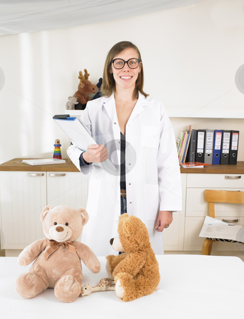 Pediatrician in Her Office stock photo, Young female pediatrician in her office. Vertically framed shot. by Mog Ddl