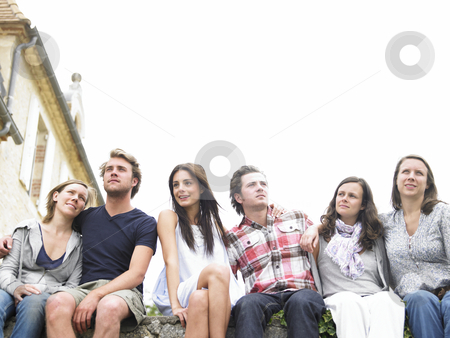 Group of Friends Outdoors, Looking Into the Distance stock photo, Group of young people sitting together outdoors, looking away into the distance. Horizontal. by Mog Ddl