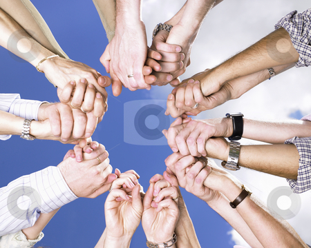 Clasped Hands in a Circle stock photo, Circle of people's arms, holding hands, with blue sky and clouds in the background. Square. by Mog Ddl