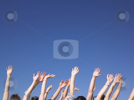 People With Arms Raised stock photo, People with hands in the air. Horizontal. by Mog Ddl