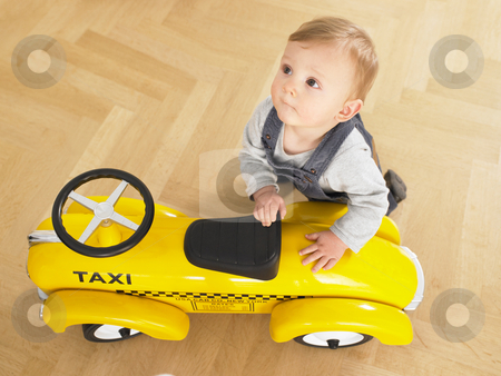 Baby with Toy Taxi stock photo, Baby playing with toy taxi cab car. Horizontally framed shot. by Mog Ddl