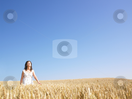 Woman in Wheat Field stock photo, A woman standing in wheat field. Horizontally framed shot. by Mog Ddl