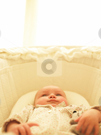 Baby in Bassinet stock photo, Baby in bassinet with toys. Vertically framed shot. by Mog Ddl