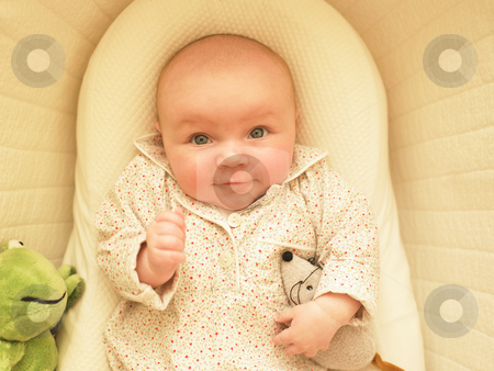 Baby in Bassinet stock photo, Baby in bassinet with toys. Horizontally framed shot. by Mog Ddl
