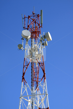 Telecommunication tower stock photo, Telecommunication tower against vivid blue sky background by Gowtum Bachoo