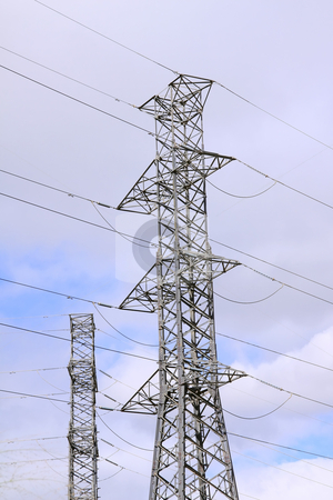 Power distribution. stock photo, High power distribution cables and poles by Gowtum Bachoo