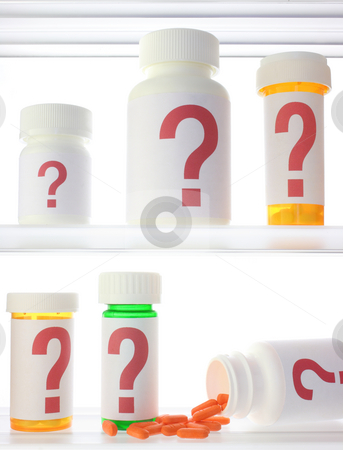 Medicine Cabinet Of Doubt stock photo, A few pill bottles in a medicine cabinet, all labeled with red question marks. One bottle is on its side with pills spilling out. by Mark Carrel