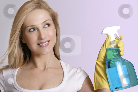 Make the House Sparkle Clean stock photo, A smiling woman cleaning up with a cleanser product in a spray bottle. by Leah-Anne Thompson