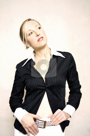 Fashion Style stock photo, Stylised fashion -- woman in black/white stripedshirt and pants with belt.  looking sideways.  This image has been given an artistic treatment. by Leah-Anne Thompson