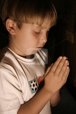 Boy saying Bedtime prayer stock photo, Boy praying by Leah-Anne Thompson