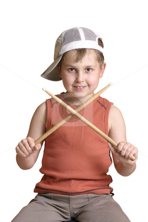 Boy with wooden drumsticks crossed. stock photo, Boy with crossed drumsticks ready to play. by Leah-Anne Thompson