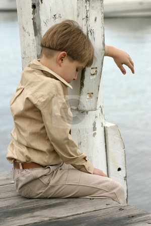 Time to Grieve stock photo, Grieving the loss of a loved one, dog/cat, etc.Boy hangs head low grieving or lonely by Leah-Anne Thompson