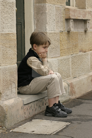Dejected stock photo, Young boy sitting on the doorstep. Feeling a little glum eg: glum, lonesome, outcast, troubled, grief, ponder by Leah-Anne Thompson