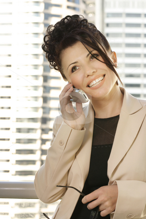 Businesswoman - Business Talk stock photo, A woman talking business and smiling. by Leah-Anne Thompson