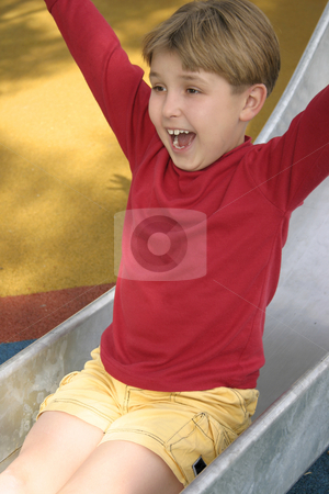 Slides of fun - slippery dip stock photo, Shrieks and shrills on the slippery slide by Leah-Anne Thompson