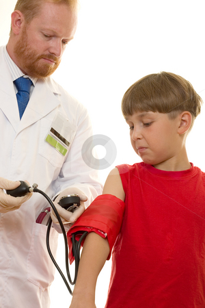 Doctor treating patient stock photo, Doctor taking a young patient's blood pressure by Leah-Anne Thompson
