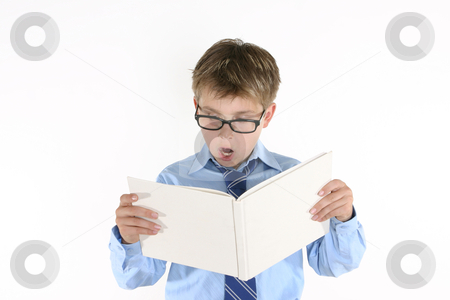 Child student reading a book stock photo, Student or child reading a book by Leah-Anne Thompson