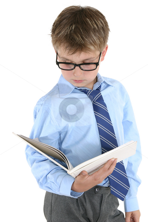 Student reading or studying stock photo, Student in uniform reading a book or studying by Leah-Anne Thompson