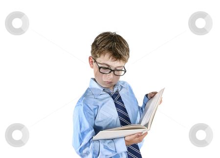 Boy reading stock photo, Boy wearing spectacles reading a book.  Please note this image has undergone a digital artistic treatment. by Leah-Anne Thompson