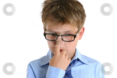 Child pushing glasses up onto nose stock photo, A child pushing his glasses up with a finger by Leah-Anne Thompson