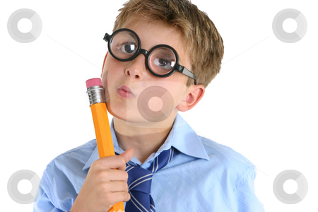 Comical boy holding a pencil and thinking stock photo, A child or schoolboy in a comical thinking pose. by Leah-Anne Thompson
