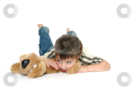 My best friend stock photo, Young toddler boy with his favorite toy dog. by Leah-Anne Thompson