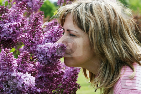 Portrait with lilac stock photo, Portrait with beauty middle-aged women and  odorous lilac by Roberts Ratuts