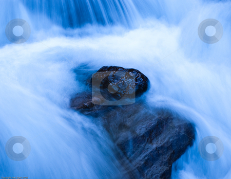 Rock in wild waters stock photo, Wild waters at Vall de Aran, northeast Spain in a very cold october morning. by Juan Egert
