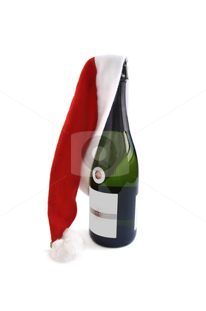 Bottle of Champagne with Santa hat. stock photo, Bottle of Champagne with Santa red hat isolated over white with empty label for text. by Liana Bukhtyyarova