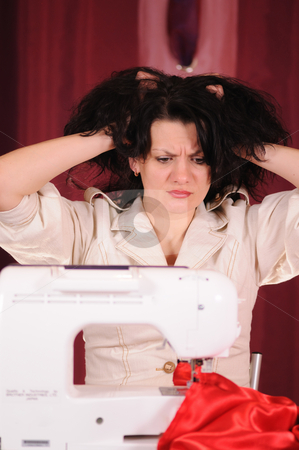 Sewing stock photo, The woman was upset because at it the dress has not turned out by Salauyou Yury