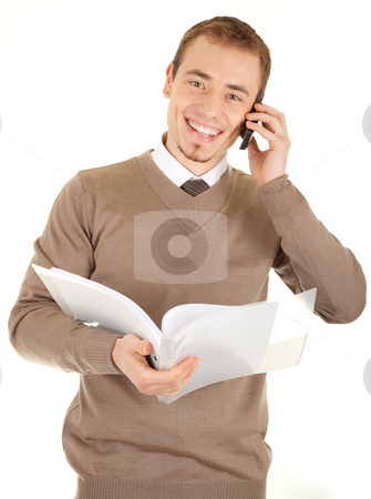 Smiling well-dressed man with documents and phone stock photo, Young well-dressed man in formalwear is talking by phone and holding a open white file with documents. Isolated on white background. by Iryna Rasko