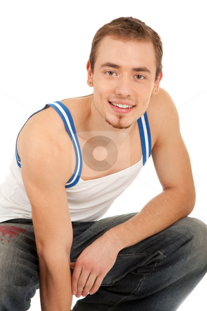 Handsome young man is looking to you stock photo, Handsome young man in T-shirt and jeans is looking to you. Isolated on white background by Iryna Rasko