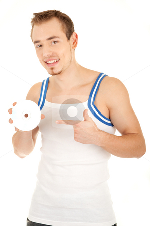 This disk is cool stock photo, Handsome smiling young man in T-shirt is showing a compact disk. Isolated on white background by Iryna Rasko