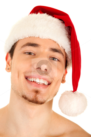 Young man in red Christmas hat stock photo, Portrait of young handsome smiling man in red Christmas hat. Isolated on white background. Focus on eyes. by Iryna Rasko
