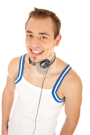 I like listen good music stock photo, Smiling handsome young man in casual style with headphones, isolated on white background by Iryna Rasko