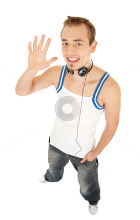 I like music and tell you hello stock photo, Smiling handsome young man in casual style with headphones shows hello by his hand, isolated on white background by Iryna Rasko