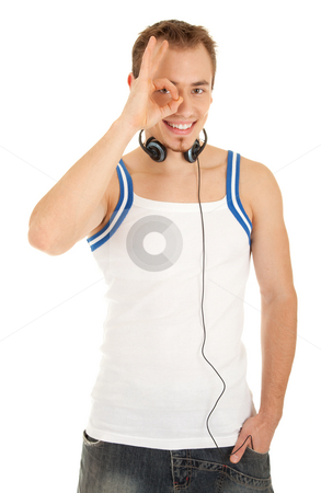 Everything is ok stock photo, Smiling handsome young man in casual style with headphones shows sign ok, isolated on white background by Iryna Rasko